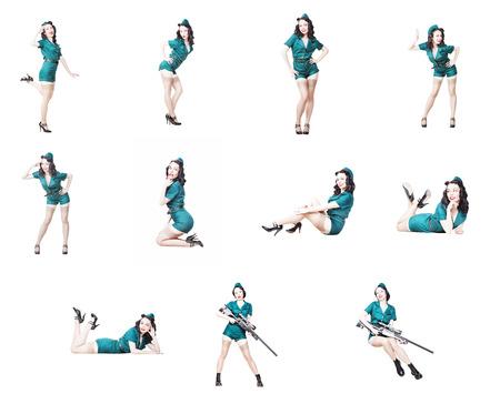 黒髪とキュートなセクシーなブルネットのセット。●ミリタリーな服に身を包んだ女性をピン留めして駐屯帽軍ピンナップガールコンセプト 写真素材