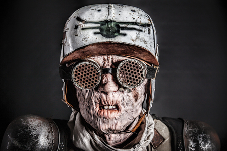 Post apocalyptic survivor masked ugly face. Skin burned by atomic flame Stock Photo