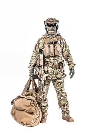 Soldier standing with duffel bag studio shot Stock Photo