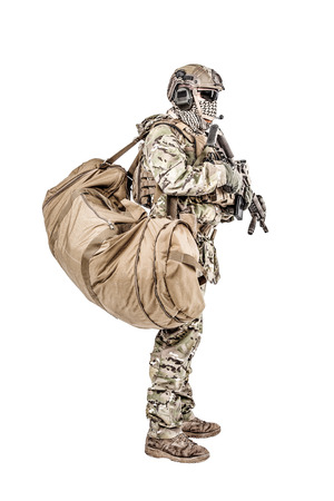 Soldier standing with duffle gym bag studio shot Stock Photo