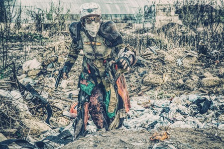 Post apocalyptic survivor creature with homemade weapons Reklamní fotografie - 89280336