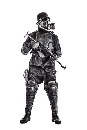 Futuristic nazi soldier gas mask and steel helmet with schmeisser handgun isolated on white studio shot full body portrait Reklamní fotografie
