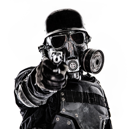 Futuristic soldier gas mask and steel helmet with luger pistol handgun isolated on white studio shot Foto de archivo