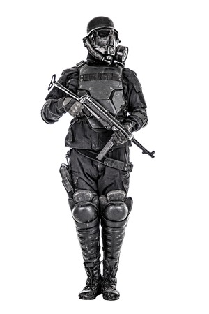 Futuristic soldier gas mask and steel helmet with schmeisser handgun isolated on white studio shot
