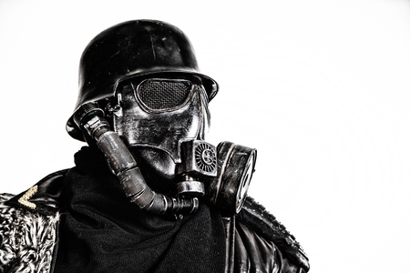 Futuristic soldier gas mask and steel helmet with schmeisser handgun isolated on white studio shot closeup portrait