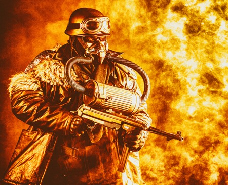 Futuristic soldier in fire and smoke gas mask and steel helmet with schmeisser handgun