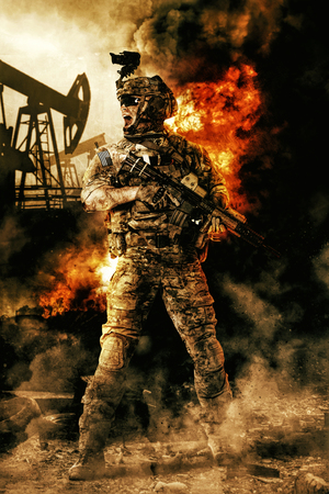 Army soldier in action. Great explosion with fire and smoke billows. Oil rig on the background