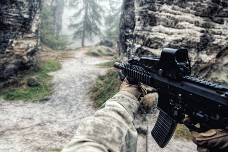 Private military contractors PMC in in action in the rocks. Original point of View POV, view in first person