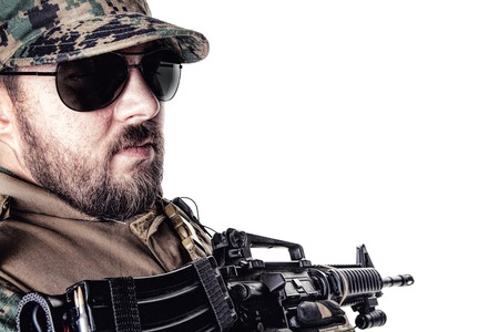 Studio shot of United States Marine with rifle weapons in uniforms turning around. Military equipment, army helmet, black glasses, tactical gloves. Isolated on white, weapons, army, patriotism concept