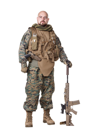 Elite member marksman of United States Marine Corps with rifle weapons in uniforms. Military equipment, army helmet, combat boots, tactical gloves. Isolated on white, weapons, army, patriotism concept Stock Photo