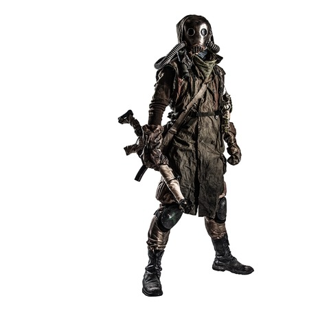 Survivor inhabitant of contaminated by nuclear catastrophe or dangerous chemical pollution world, in tatters and gas mask, standing with handmade firearm gun, isolated on white background studio shoot Фото со стока