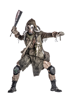 Aggressive and evil humanoid monster or creature of post apocalyptic, poisoned by dangerous pollution world wearing tattered rags and gas mask, brandishing bloodstained machete studio shoot on white