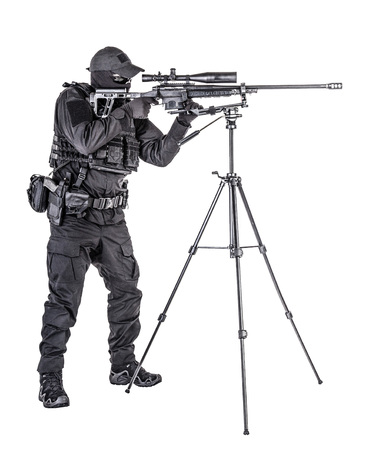 Police SWAT sniper aiming with rifle studio shoot Banco de Imagens