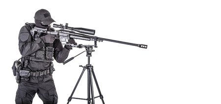 Police SWAT sniper aiming with rifle studio shoot Stock Photo