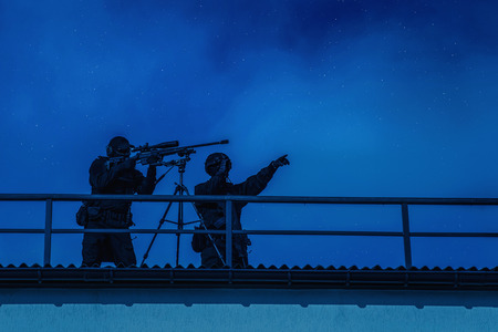 Sniper team searching target on city night mission