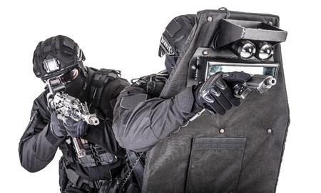 SWAT team behind ballistic shield studio shoot