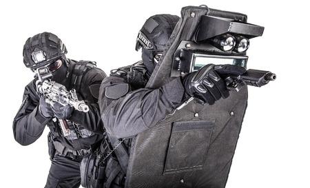 SWAT team behind ballistic shield studio shoot Imagens
