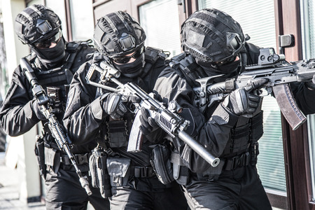 Police counter terrorist team squad storming building Stock Photo