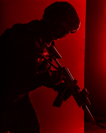 SWAT fighter with silenced assault rifle shoot Stock Photo