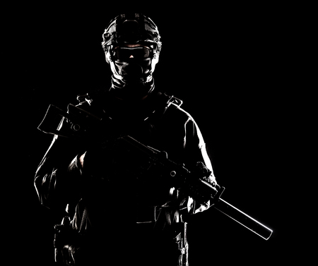 SWAT officer with service rifle low key portrait