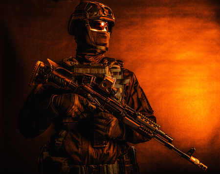 Special forces soldier posing with service rifle