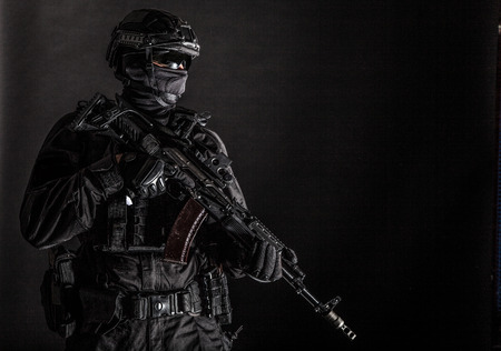 Elite police squad member in tactical ammunition