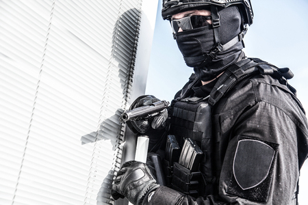 Police SWAT armed fighter ready to break in room Stock Photo