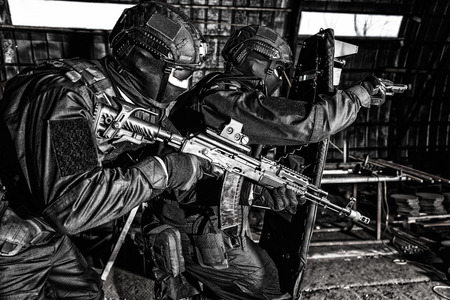 Police special reaction team squad attacking criminals Stock Photo