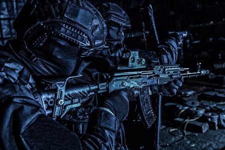 Police special reaction team attacking criminals in the dark