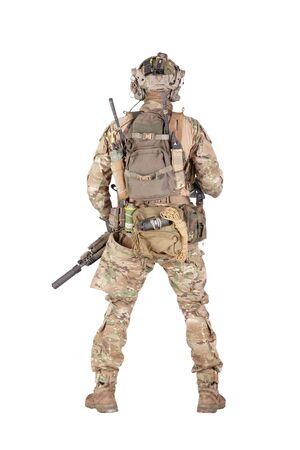 Armed army soldier standing backwards studio shoot Фото со стока - 129011745