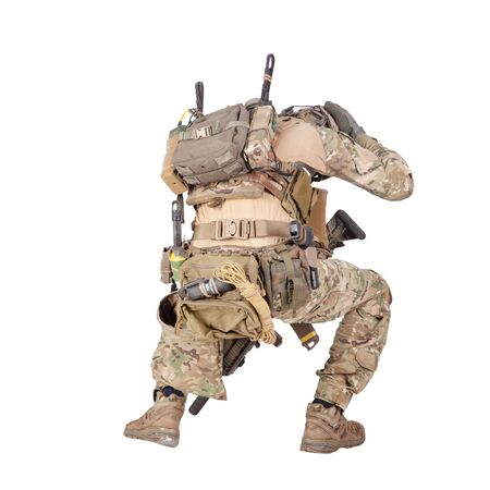Infantryman hiding from explosion studio shoot isolated on white Imagens