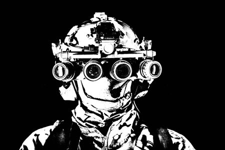 Soldier in night view goggles low key studio shoot