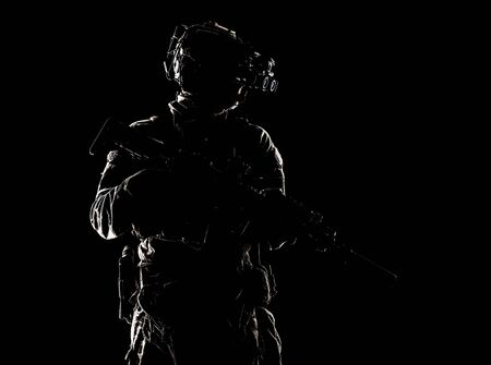 Special forces fighter in darkness studio shoot