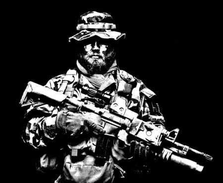 Commando soldier in battle ammunition, armed rifle Banque d'images