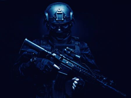 Equipped SWAT team fighter armed assault rifle