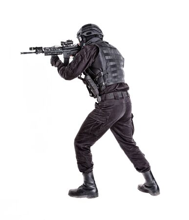 Police special forces shooter sneaking with rifle