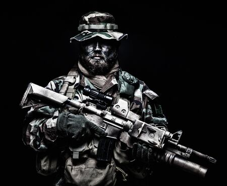 Commando soldier in battle ammunition, armed rifle Stock Photo - 132574675
