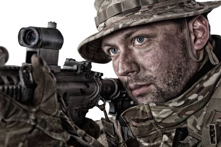Close-up portrait of army soldier aiming rifle Imagens