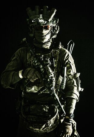 Army elite troops serviceman standing in darkness