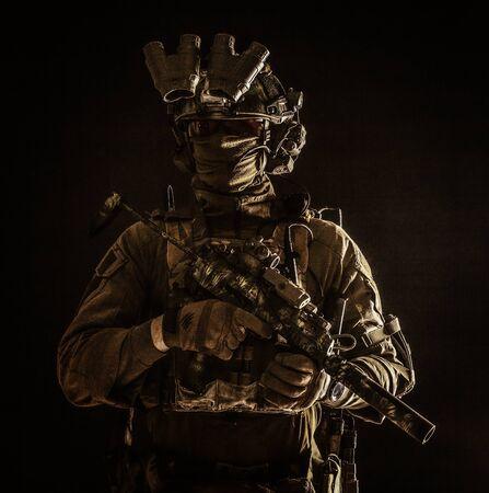 Portrait of elite commando fighter in darkness