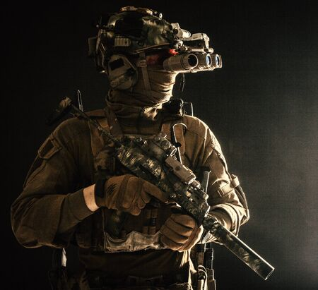 Army special forces tactical group fighter in dark Standard-Bild