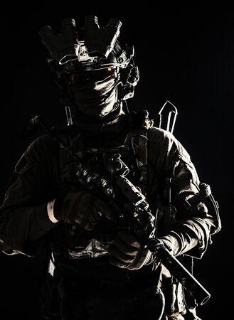 Army elite troops serviceman standing in darkness