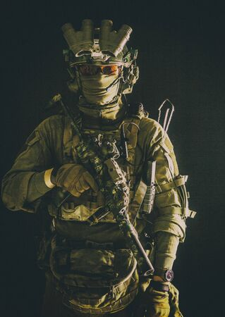 Anti-terrorist squad equipped fighter soldier in darkness Stock Photo - 137538634