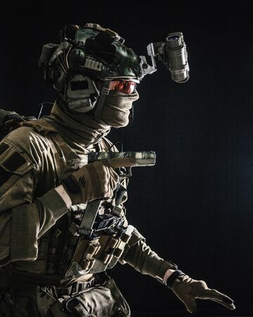 Military security service fighter sneaking in dark Standard-Bild