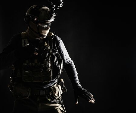 Army infantryman moving in darkness with caution Stockfoto