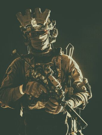 Anti-terrorist squad equipped fighter soldier in darkness