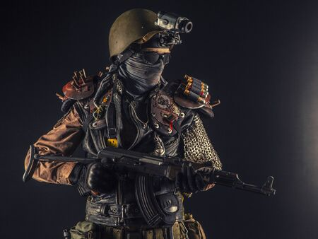 Nuclear post apocalypse life after doomsday concept. Grimy survivor with homemade weapons. Studio portrait