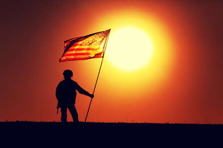 Silhouette of US army infantry soldier, United States Marines Corps fighter standing on sunset horizon with waving USA national flag. Soldiers heroism and victory in battle, honoring of fallen heroes