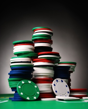 stack of business cards: poker chips