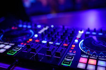closeup view of a DJs mixing desk Archivio Fotografico